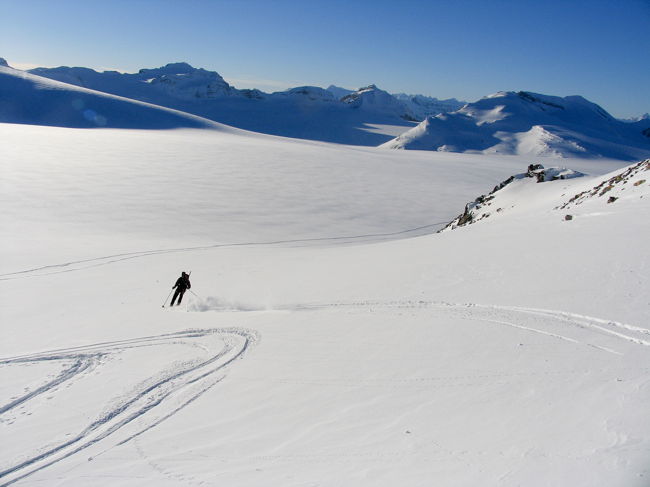 JW skis off the col down to the main ice field.