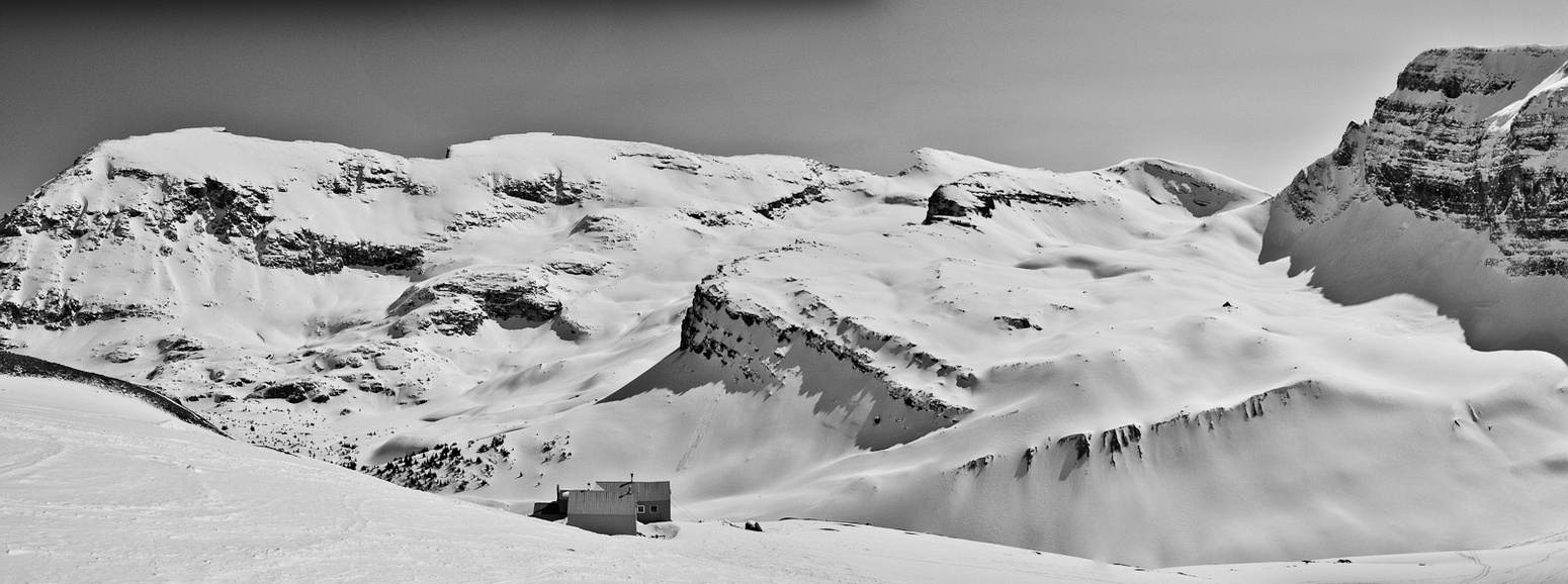 Skiing onto the Wapta Icefield. The Bow Hut is below us now. Crowfoot mountain in the background.