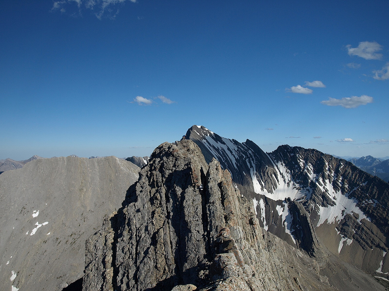 A slightly wider view of Kev on the crux down climb with Wietse above him on the ridge - definitely not easy terrain!