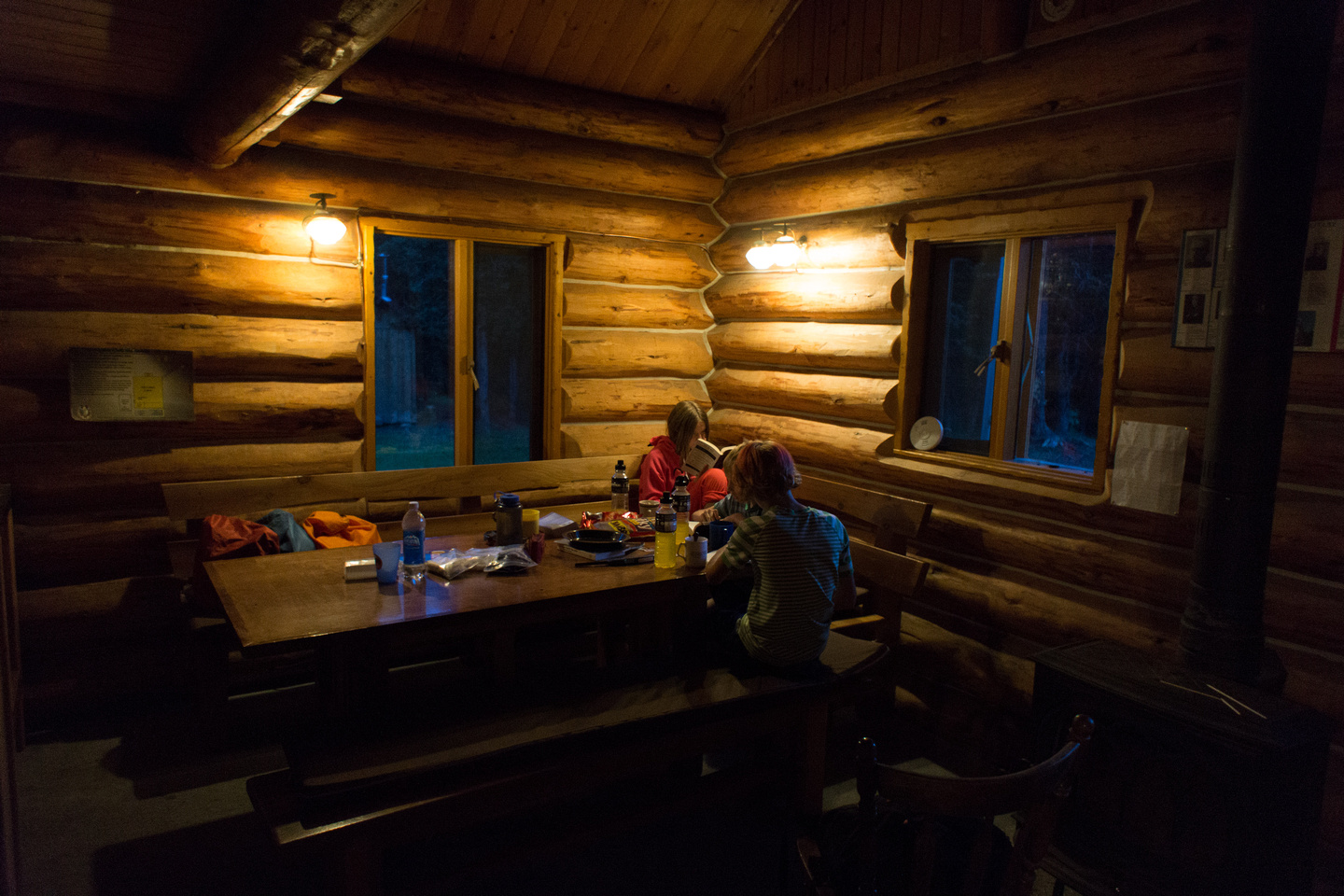 The Elk Lakes ACC Hut is cozy at night.