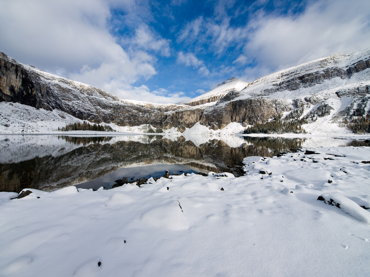 One more wide-angle shot of Rockbound Lake with some blue sky and fresh snow.