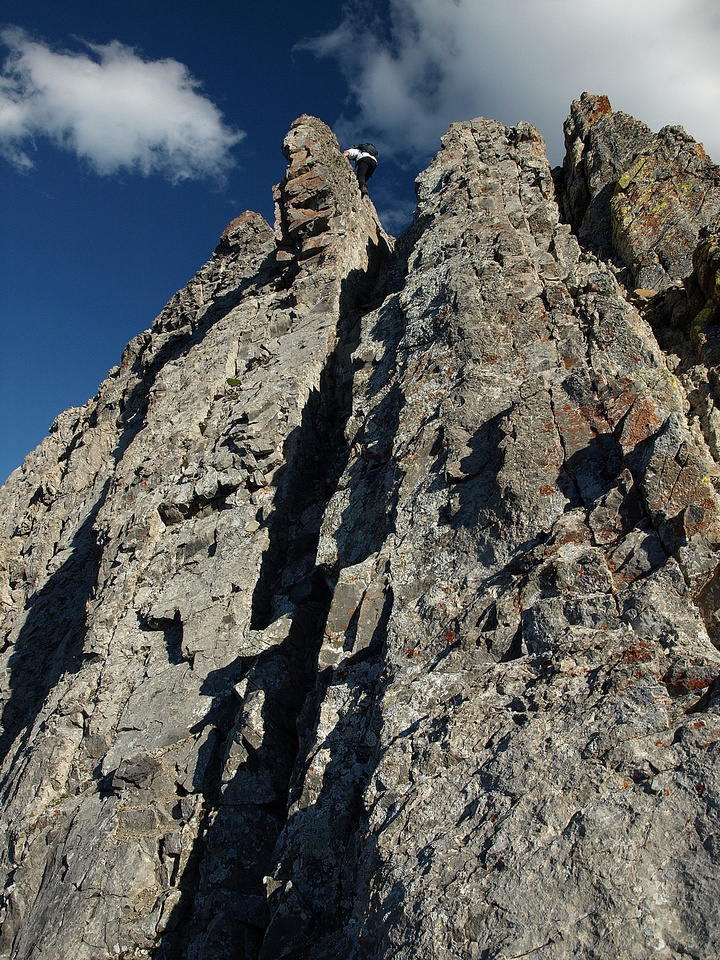 Looking back as Kev starts the down climb of the crux.