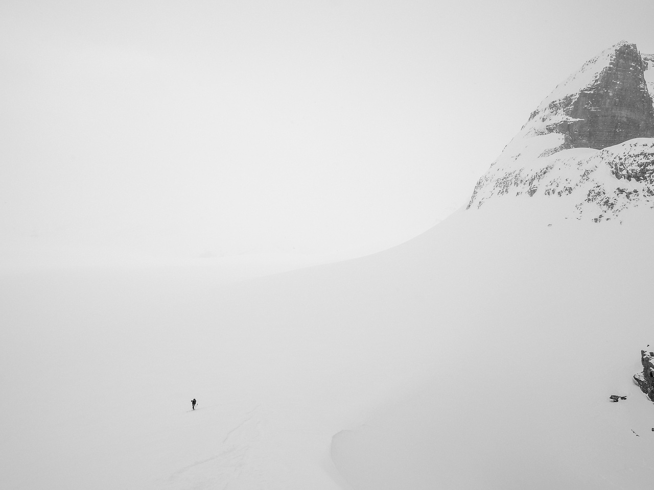 The icefield is totally socked in as we ski off the arete.