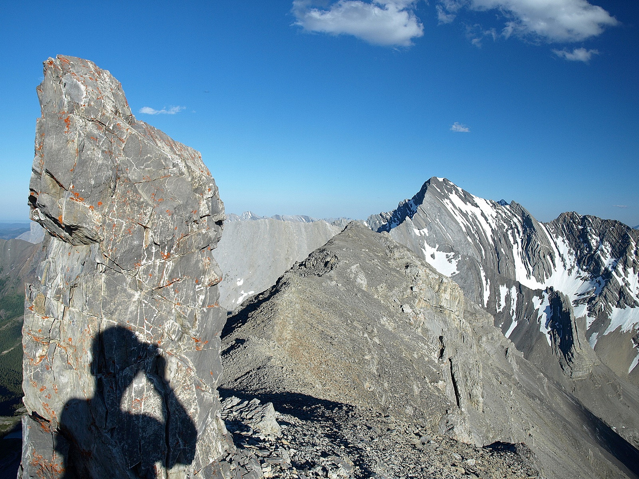 Heading back along the summit ridge - Storm Mountain on the right.