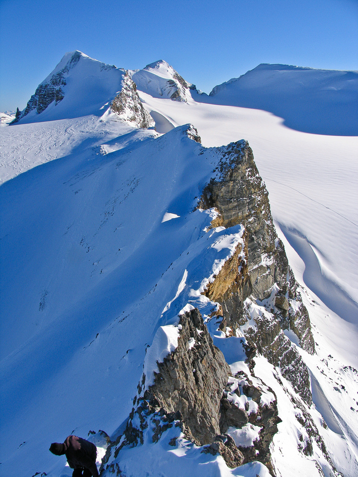 JW carefully down climbs the crux from the summit of St. Nicholas.