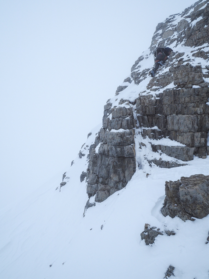 You REALLY don't want to slip here! Steven is on the crux of the descent, steep and very loose rock on slabs which is tricky to climb in ski boots!