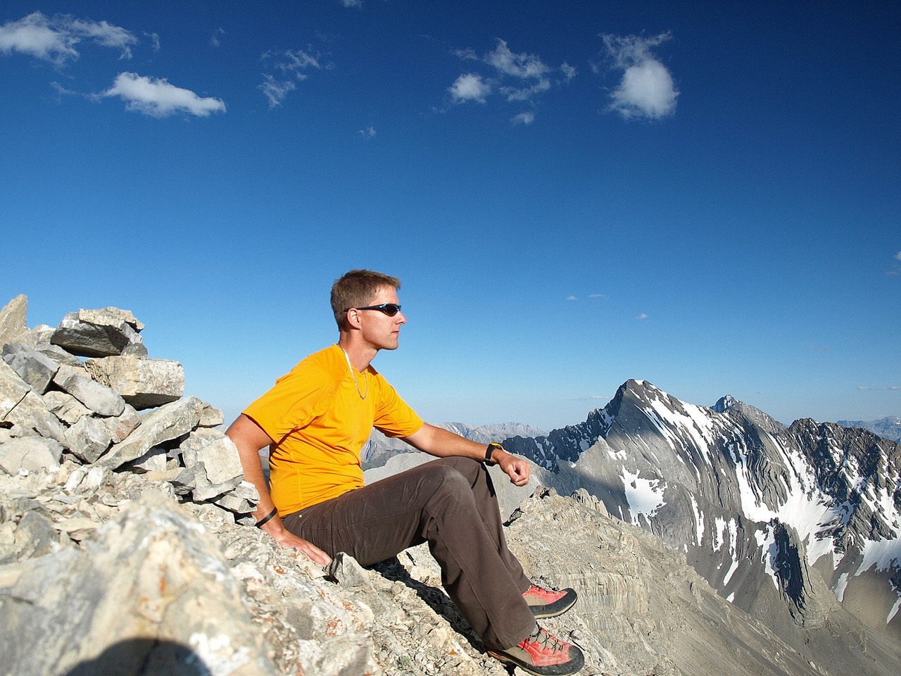 Vern on the summit with Storm Mountain to the south.