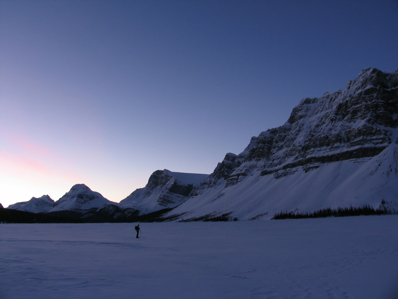 A clear, cold morning as we cross Bow Lake - always the coldest place around. Bow Peak in the distance at left.