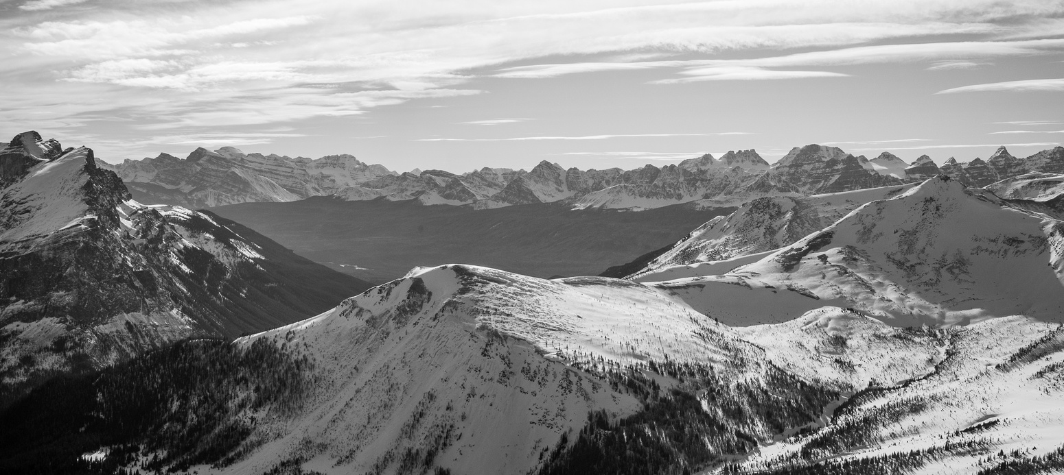 Looking over Hwy 1 to Lake Louise and other Banff Peaks. Unity Peak looks tiny at lower right.
