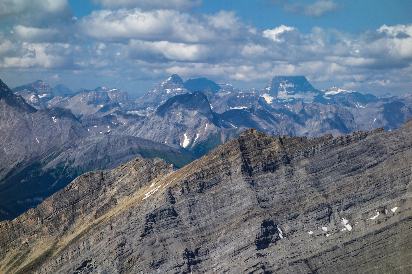Mount Assiniboine makes a partial appearance with Eon and Aye to its left and Smuts in the foreground at center.