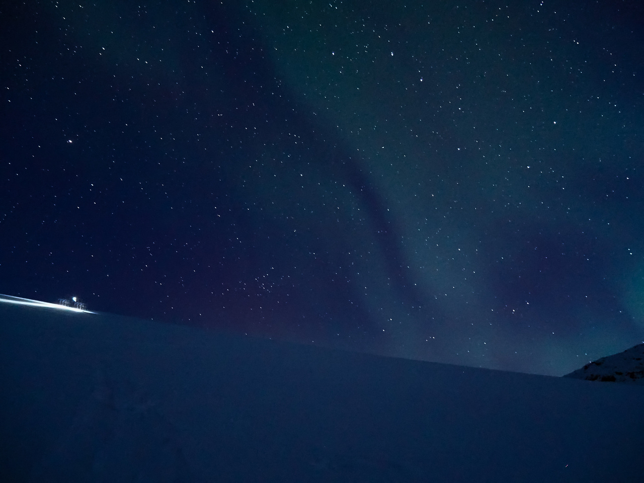 Northern lights, stars and Steven's head lamp as we work our way up the headwall to the main Wapta Icefield.