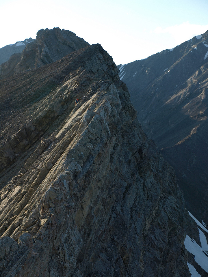 From the top of the crux - that I've just re-climbed - you can see that the terrain to the summit isn't easy - Wietse is carefully down climbing it.