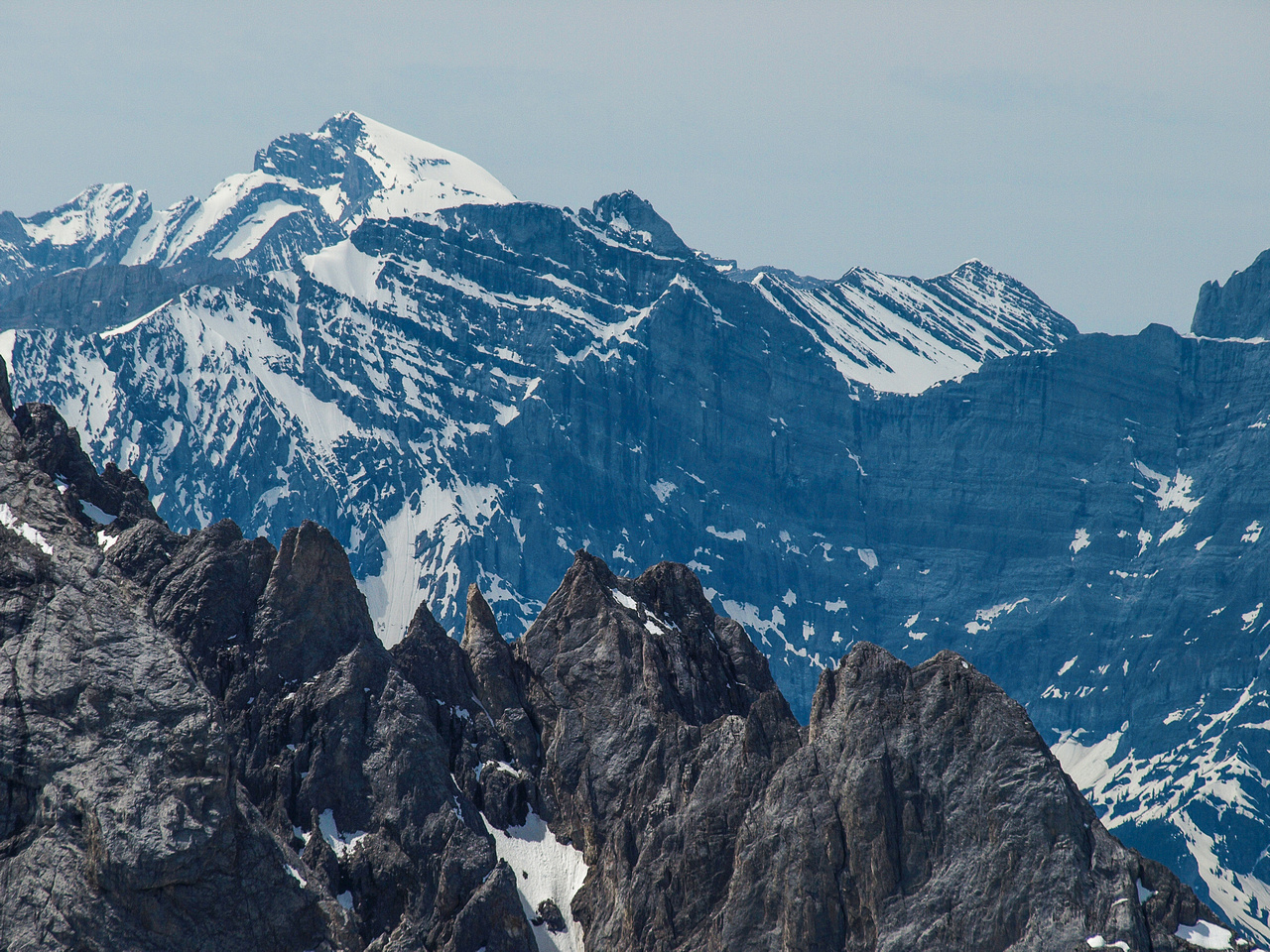 Mount Joffre pokes its head above the other peaks in this view to the south west.